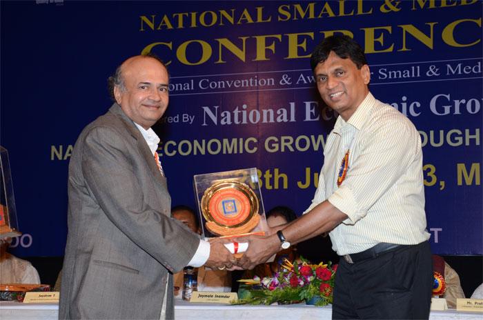 Mr Deepak Kapadia receiving Quality Brand Award